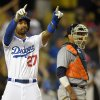 Photo - Los Angeles Dodgers' Matt Kemp, left, gestures toward Dee Gordon at first as Detroit Tigers catcher Victor Martinez looks on during the ninth inning of a baseball game, Wednesday, April 9, 2014, in Los Angeles. Kemp scored on a single by Gordon. (AP Photo/Mark J. Terrill)