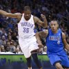 Dallas Mavericks forward Caron Butler, right, drives to the basket around Oklahoma City Thunder forward Kevin Durant during the first half of an NBA basketball game in Oklahoma City, Monday, Dec. 27, 2010. Dallas won 103-93. (AP Photo/Alonzo Adams)