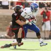 Texas Tech\'s Cody Davis tries to drag down Kansas\' James Sims during their NCAA college football game in Lubbock, Texas, Saturday, Nov. 10, 2012. (AP Photo/Lubbock Avalanche-Journal, Zach Long) LOCAL TV OUT