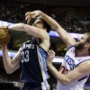 Philadelphia 76ers\' Spencer Hawes, right, defends against Memphis Grizzlies\' Marc Gasol, of Spain, during the first half of an NBA basketball game, Monday, Jan. 28, 2013, in Philadelphia. (AP Photo/Matt Slocum)