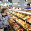 Kelly Porter shops the bakery on the opening day of the new Uptown Grocery in Edmond, February 29, 2012. Photo by David McDaniel, The Oklahoman