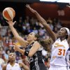 San Antonio Silver Stars\' Becky Hammon, left, drives past Connecticut Sun\'s Tina Charles during the first half of their WNBA basketball game in Uncasville, Conn., Friday, May 25, 2012. (AP Photo/Fred Beckham)