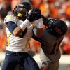West Virginia\'s Stedman Bailey (3) catches a pass as Oklahoma State\'s Brodrick Brown (19) defends during a college football game between Oklahoma State University (OSU) and the West Virginia University at Boone Pickens Stadium in Stillwater, Okla., Saturday, Nov. 10, 2012. Photo by Sarah Phipps, The Oklahoman