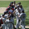 Photo - The Cleveland Indians players celebrate their team's 5-4 win against the Los Angeles Dodgers in a baseball game on Wednesday, July 2, 2014, in Los Angeles. (AP Photo/Jae C. Hong)