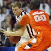 Syracuse\'s Rick Jackson (00) fouls Oklahoma\'s Blake Griffin (23) during the first half of the NCAA Men\'s Basketball Regional at the FedEx Forum on Friday, March 27, 2009, in Memphis, Tenn. PHOTO BY CHRIS LANDSBERGER, THE OKLAHOMAN