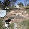 Photo -      Residents of Meadow Ridge Mobile Home Park in Shawnee have been told they have to move out due to elevated uranium levels. This is a lot were a trailer was pulled out Wednesday. Photo by David McDaniel, The Oklahoman   David McDaniel -