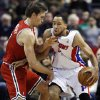 Photo - Detroit Pistons forward Tayshaun Prince (22) takes a hit in the throat from Milwaukee Bucks forward Mike Dunleavy while going to the basket in the first half of an NBA basketball game, Sunday, Dec. 30, 2012, in Auburn Hills, Mich. (AP Photo/Duane Burleson)