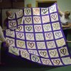 Members of the Quilting Divas of Harrah United Methodist Church admire their