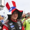 Photo - Chris Buescher wears a patriotic hat on pit road before the Nationwide series auto race at Daytona International Speedway in Daytona Beach, Fla., Friday, July 4, 2014. (AP Photo/Terry Renna)