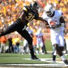 Oklahoma State wide receiver Justin Blackmon, right, catches an 8-yard touchdown pass as Missouri defensive back E.J. Gaines defends during the first half of an NCAA college football game, Saturday, Oct. 22, 2011, in Columbia, Mo. (AP Photo/L.G. Patterson)
