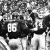 Former OU linebacker Brian Bosworth and other members of the OU defense celebrate after stopping the Stanford Cardinals for a 5-yard loss in the 4th quarter of the OU-Stanford game in 1984. The Sooners won the game, 19-7. PHOTO BY JIM ARGO, The Oklahoman Archives