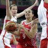 Russia\'s Becky Hammon (9) is defended by Canada\'s Kim Smith, left, and Natalie Achonwa, right, during the first half of a preliminary women\'s basketball game at the 2012 Summer Olympics, Saturday, July 28, 2012, in London. (AP Photo/Eric Gay)