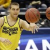 Michigan forward Mitch McGary passes the balls during a practice session for their NCAA college basketball tournament game Wednesday, March 19, 2014, in Milwaukee. Michigan plays Wofford on Thursday. (AP Photo/Morry Gash)