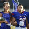Moore\'s Mariah Davis is crowned homecoming queen and is escorted by Ryan Lujan-Leonard as the Moore High School Lions play the Putnam City North Panthers in high school football on Thursday, Oct. 3, 2013, in Moore, Okla. Photo by Steve Sisney, The Oklahoman