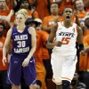 OSU\'s Toni Young (15) reacts after making a basket while being fouled by James Madison\'s Nikki Newman (30) during the Women\'s NIT championship college basketball game between Oklahoma State University and James Madison at Gallagher-Iba Arena in Stillwater, Okla., Saturday, March 31, 2012. Photo by Nate Billings, The Oklahoman
