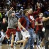 Fans flood the court as the University of Oklahoma Sooners (OU) defeat the Kansas Jayhawks (KU) 72-66 in NCAA, men\'s college basketball at The Lloyd Noble Center on Saturday, Feb. 9, 2013 in Norman, Okla. Photo by Steve Sisney, The Oklahoman