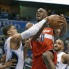 Washington Wizards\' Emeka Okafor, center, is fouled by Orlando Magic\'s Tobias Harris, left, as Magic\'s Jameer Nelson, right, watches during the first half of an NBA basketball game, Friday, March 29, 2013, in Orlando, Fla. (AP Photo/John Raoux)