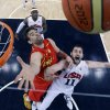 Spain\'s Marc Gasol, left, and United States\' Kevin Love, right, reach for a rebound during the men\'s gold medal basketball game at the 2012 Summer Olympics, Sunday, Aug. 12, 2012, in London. (AP Photo/Eric Gay, pool)