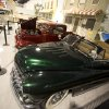 This Monday, Nov. 26, 2012 photo shows a 1950 Mercury Custom Convertible and other hot rods in a North Palm Beach, Fla. private auto museum. .John Staluppi has spent a lifetime selling cars, so successful in his trade he boasts more than two dozen dealerships and more sales than he ever could count. But even he has never seen a sale like this. Staluppi is liquidating his Cars of Dreams Museum and its 115 collector vehicles in an auction Saturday. The Batmobile, the Evel Knievel motorcycle, the lines and lines of perfectly shined cars, all of them will be gone.