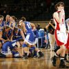 The Vinita Lady Hornets celebrate as Cache\'s Lindsey Carter (14) and Kayla Jensen (12) leave the court after the Class 4A girls championship game between Vinita and Cache in the Oklahoma High School Basketball Championships at State Fair Arena in Oklahoma City, Saturday, March 14, 2009. Vinita won, 51-45. PHOTO BY NATE BILLINGS, THE OKLAHOMAN
