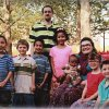 The Corcoran family, of Norman, from left, are: Malachi, 7; Joshua, 7; Micah, 8; Curtis, 30; Liliana, 10; Silas, 8 months; Beth, 32; Isabella, 5; and Abe, 5. The Corcorans adopted baby Silas through Deaconess Pregnancy and Adoption Services when he was about a week old. PHOTO PROVIDED