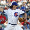 Photo - FILE - In this June 23, 2014, file photo, Chicago Cubs starting pitcher Jeff Samardzija delivers during the first inning of a baseball game against the Cincinnati Reds in Chicago. The Oakland Athletics have an agreement in place to acquire right-handers Jeff Samardzija and Jason Hammel from the Cubs for three top-line prospects in a surprising trade for baseball's top team, two people with knowledge of the deal said Friday night, July 4, 2014. (AP Photo/Charles Rex Arbogast, File)