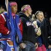 Moore fans Densil Johnson, Lucas Rollins and Brenna Franklin are dressed for the cold as the Moore Lions play the Lawton Eisenhower Eagles in a high school football game on Friday, Oct. 5, 2012, in Moore, Okla. Photo by Steve Sisney, The Oklahoman
