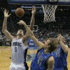 Orlando Magic\'s Nikola Vucevic (9), of Montenegro, goes after a rebound against Dallas Mavericks\' Dirk Nowitzki (41), of Germany, and Chris Kaman (35), during the first half of an NBA basketball game, Sunday, Jan. 20, 2013, in Orlando, Fla. (AP Photo/John Raoux)