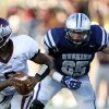 Edmond Memorial\'s Warren Wand is chased down by Edmond North\'s Joel Dixon during the high school football game between Edmond North and Edmond Memorial at Wantland Stadium in Edmond, Okla., Friday, Aug. 31, 2012. Photo by Sarah Phipps, The Oklahoman