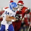 Bridge Creek\'s Chris Golden (24) tries to break away from Purcell\'s Cornell Haley (64) during a high school football playoff game between Purcell and Bridge Creek at Conger Field in Purcell, Okla.,Friday, Nov. 11, 2011. Photo by Nate Billings, The Oklahoman