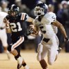Minco\'s Jacob Smart (5) runs for a touchdown in front of Wayne\'s Charlie Gardner (21) during a high school football playoff game between Wayne and Minco in Wayne, Okla., Friday, Nov. 25, 2011. Photo by Nate Billings, The Oklahoman