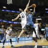 Photo - Minnesota Timberwolves forward Corey Brewer (13) goes to the basket against Memphis Grizzlies center Kosta Koufos (41) in the first half of an NBA basketball game Monday, March 24, 2014, in Memphis, Tenn. (AP Photo/Lance Murphey)