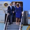 President Barack Obama and first lady Michelle Obama depart Air Force One at Boston\'s Logan International Airport in Boston, Thursday, April 18, 2013, before attending an interfaith service for the victims of the bombings at the finish line of the Boston Marathon. Also seen is Rep. Michael Capuano, D-Mass. is at center. (AP Photo/Josh Reynolds)