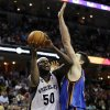 Memphis Grizzlies\' Zach Randolph (50) shoots in front of Oklahoma City Thunder\'s Nick Collison in overtime of an NBA basketball game in Memphis, Tenn., Wednesday, March 20, 2013. The Grizzlies won 90-89. (AP Photo/Danny Johnston)