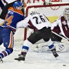 Colorado Avalanche goalie Semyon Varlamov makes the save as Paul Stastny (26) and Edmonton Oilers\' Ryan Smyth battle for the rebound during the first period of their NHL hockey game, Monday, Jan. 28, 2013, in Edmonton, Alberta. (AP Photo/The Canadian Press, Jason Franson)