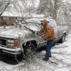 Jamie Cherry with Martin\'s Tree Service out of Crumville, Louisiana, removes tree limbs on Friday, Jan. 29, 2010, in Purcell, Okla. Power lines, homes and vehicles were damaged after a winter storm. Photo by Steve Sisney, The Oklahoman