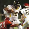 Madill\'s Spencer Bond (8) carries and Purcell\'s James Wolfe (21) tries to stop him in high school football as Madill plays at Purcell on Thursday, Oct. 1, 2010, in Purcell, Okla. Photo by Steve Sisney, The Oklahoman