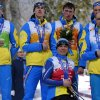 Photo - Ukraine's team, from left: Ihor Reptyukh, Vitaliy Kazakov, Olena Iurkovska, Iurii Utkin, Borys Babar and Vitaliy Lukyanenko cover their silver medals with their hands after finishing second in cross country 4x2.5km open relay at the 2014 Winter Paralympic, Saturday, March 15, 2014, in Krasnaya Polyana, Russia. The majority of Ukraine's Paralympic medalists covered their medals during medal ceremonies. (AP Photo/Dmitry Lovetsky)