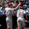 Cincinnati Reds\' Zack Cozart, right, celebrates with Todd Frazier after scoring during the fifth inning of a baseball game against the New York Yankees at Yankee Stadium, Sunday, July 20, 2014, in New York. (AP Photo/Seth Wenig)