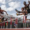 Bixby\'s Logan Smalley clears the hurdle in the 6A boys 110m hurdles during the class 5A and 6A track state championships at Yukon High School on on Friday, May 10, 2013, in Yukon, Okla.Photo by Chris Landsberger, The Oklahoman