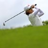 Na Yeon Choi of South Korea tees off on the 8th hole during the final round of the HSBC Women\'s Champions golf tournament Sunday, March 3, 2013, in Singapore. (AP Photo/Wong Maye-E)
