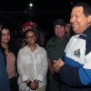 Photo -   In this photo released by Miraflores Press Office, Venezuela's President Hugo Chavez, right, speaks with members of his staff including Vice President Elias Jaua, left, upon his arrival to the airport in Maiquetia near Caracas, Venezuela, Thursday, April 26, 2012. Chavez has returned home after 11 days in Cuba where he was undergoing radiation therapy treatment. (AP Photo/Miraflores Press Office, Efrain Gonzalez)