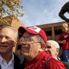Barry Switzer poses for photos with fans as his grandchildren play on a statue of the former coach before the college football game between the Texas A&M Aggies and the University of Oklahoma Sooners (OU) at Gaylord Family-Oklahoma Memorial Stadium on Saturday, Nov. 5, 2011, in Norman, Okla. Photo by Bryan Terry, The Oklahoman