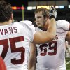 Oklahoma\'s Tyler Evans (75) and Lane Johnson (69) console each other during the second half of the college football game in which the University of Oklahoma Sooners (OU) was defeated 45-38 by the Baylor Bears (BU) at Floyd Casey Stadium on Sunday, Nov. 20, 2011, in Waco, Texas. Photo by Steve Sisney, The Oklahoman ORG XMIT: KOD