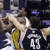 Photo - Indiana Pacers center Ian Mahinmi, left, is fouled by Brooklyn Nets forward Kris Humphries (43) as he shoots in the first half of an NBA basketball game in Indianapolis, Monday, Feb. 11, 2013.  (AP Photo/Michael Conroy)