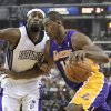 Photo -   Los Angeles Lakers forward Meta World Peace, right, drives against Sacramento Kings forward John Salmons during the first quarter of an NBA basketball game in Sacramento, Calif., Wednesday, Nov. 21, 2012.(AP Photo/Rich Pedroncelli)