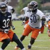Chicago Bears linebacker Khaseem Greene (60) works with teammates during NFL football training camp Friday, July 26, 2013, at Olivet Nazarene University in Bourbonnais, Ill. (AP Photo/Nam Y. Huh)
