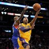Photo - Los Angeles Lakers guard Kobe Bryant, right, shoots past Philadelphia 76ers guard Jason Richardson in the first half of an NBA basketball game, Tuesday, Jan. 1, 2013, in Los Angeles. (AP Photo/Gus Ruelas)
