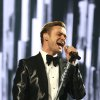 """Photo - FILE - In this Feb. 20, 2013 file photo, Justin Timberlake performs on stage during the BRIT Awards 2013 at the o2 Arena in London. Nielsen SoundScan announced Tuesday, March 26, 2013, that the singer's third album, """"The 20/20 Experience,"""" has moved 968,000 units. It's the 19th album in Nielsen's 12-year history that has sold more than 900,000 albums in a single week. (Photo by John Marshall/Invision/AP, File)"""