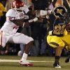 Oklahoma\'s Sam Proctor (27) tries to stop Missouri\'s De\'Vion Moore (26) during the second half of the college football game between the University of Oklahoma Sooners (OU) and the University of Missouri Tigers (MU) on Saturday, Oct. 23, 2010, in Columbia, Mo. Oklahoma lost the game 36-27. Photo by Chris Landsberger, The Oklahoman